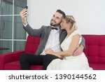 couples are happily taking a... | Shutterstock . vector #1390144562