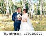 beautiful bride in a white... | Shutterstock . vector #1390153322