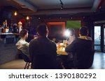 Stock photo friends in the sports bar watching tv 1390180292