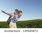 two brothers outdoors happy play | Shutterstock . vector #139044872