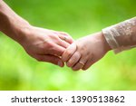 close up hands of lovers on the ... | Shutterstock . vector #1390513862