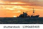 A Fishing Vessel Tows A Fishin...