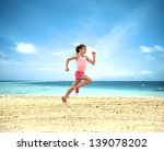 Little Girl Running Along  Ocean