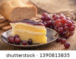sweet blueberry cake with grapes | Shutterstock . vector #1390813835