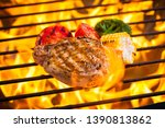 beef steak on the grill with... | Shutterstock . vector #1390813862
