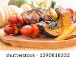 beef bbq with pumpkin on table | Shutterstock . vector #1390818332
