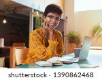 Stock photo happy brazilian girl with eyewear in coworking office with laptop looking at camera smiling 1390862468