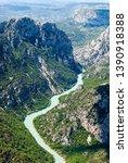 view over a mountainous... | Shutterstock . vector #1390918388