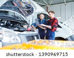 two young repairmen in workwear ... | Shutterstock . vector #1390969715