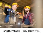 young engineer or technician in ... | Shutterstock . vector #1391004248