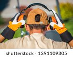Worker Wearing Noise Reduction...
