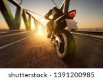 motorcycle on a bridge during... | Shutterstock . vector #1391200985
