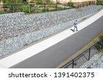 man walking on a concrete... | Shutterstock . vector #1391402375