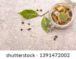 Stock photo slices of herring with spices in a glass jar mustard seeds bay leaf pepper mix healthy 1391472002