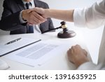 lawyer with client hands... | Shutterstock . vector #1391635925