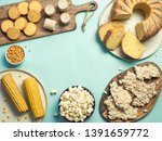 Small photo of Festa Junina traditional food background,copy space for text. Delicious sweets for Brazilian Festa Junina Party: cornmeal cake Bolo de Fuba, corn cookies,popcorn,peanut candy Pacoca, corn ear top view