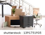 moving boxes and furniture in... | Shutterstock . vector #1391751935