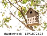 wooden cottage hanging on an... | Shutterstock . vector #1391872625