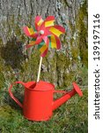 Red Watering Can And Pin Wheel