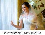 beautiful bride in white... | Shutterstock . vector #1392102185