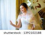 beautiful bride in white... | Shutterstock . vector #1392102188