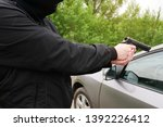 Hijacking a car. threat of a...