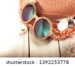 glasses hat cockleshells on... | Shutterstock . vector #1392253778