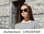 outdoor urban portrait of a... | Shutterstock . vector #1392369305