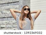outdoor urban portrait of a... | Shutterstock . vector #1392369332