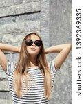 outdoor urban portrait of a... | Shutterstock . vector #1392369335