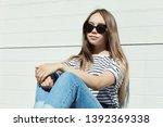 outdoor urban portrait of a... | Shutterstock . vector #1392369338