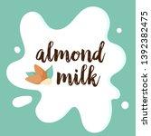 almonds on white milk splashing.... | Shutterstock .eps vector #1392382475