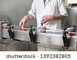 operator checking quality at... | Shutterstock . vector #1392382805
