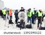 microphone in focus against... | Shutterstock . vector #1392390122
