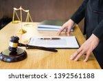 lawyer judge reading documents...   Shutterstock . vector #1392561188