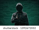 computer hacker in mask and... | Shutterstock . vector #1392672032