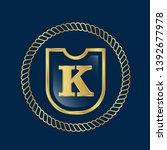 letter k on the gold shield.... | Shutterstock .eps vector #1392677978