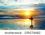 Surfer On The Ocean Beach At...