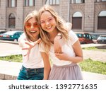 two young beautiful blond... | Shutterstock . vector #1392771635