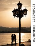 Streetlight In Sunset With Two...