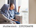 happy muslim indonesian couple... | Shutterstock . vector #1392936698