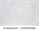 Crocodile skin gray, white, color, perfectly will be suitable for any design purposes. Leather texture. - stock photo