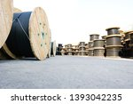 wooden coils of electric cable... | Shutterstock . vector #1393042235