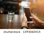men check emails with mobile... | Shutterstock . vector #1393060415