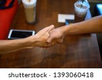 two men join hands for business ... | Shutterstock . vector #1393060418