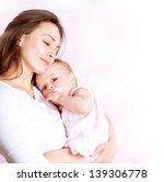 Stock photo mother and baby kissing and hugging happy family 139306778