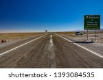 Sign of Tropic of Capricorn and car in Atacama Desert, Chile