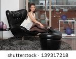 young  beautiful girl sits in a ... | Shutterstock . vector #139317218
