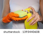 hand holding a sponge  pouring... | Shutterstock . vector #1393440608