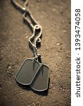 old and worn blank dog tags | Shutterstock . vector #1393474058
